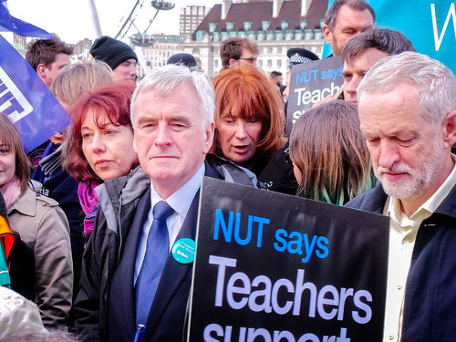 John McDonnell (left), the Labour Party's shadow chancellor, stands next to Jeremy Corbyn, its leader, at a demonstration.