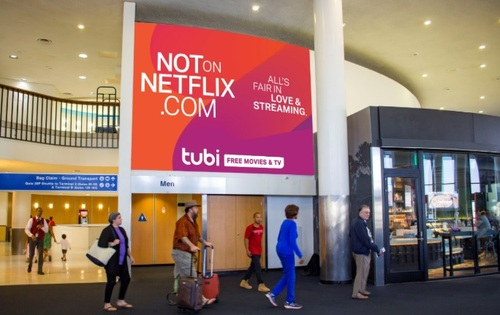 The billboard element of Tubi's ad campaign is focused on New York and Los Angeles, including airports such as JFK and LAX. Pictured is a billboard mock-up for LAX.
