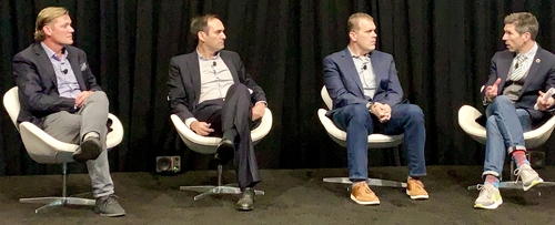 Boingo Wireless's Derek Peterson (left); Ericsson's Manuel Ruiz, Verizon's Justin Blair and GSMA's Peter Jarich and his socks.