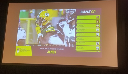 For the pilots in Philadelphia, the GameOn app running on Comcast's X1 platform appears as an 'L-bar' alongside the live TV feed of the sports event.