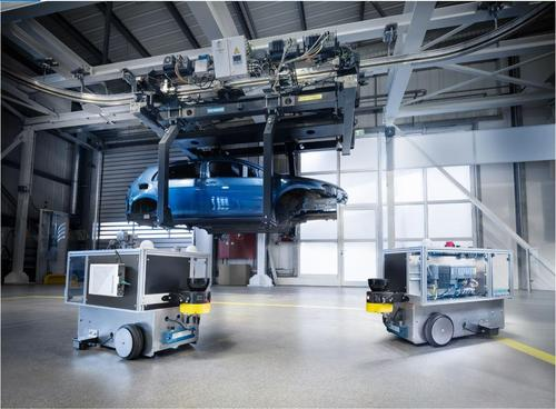Siemens tested connecting automated guided vehicles (AGVs, seen on the factory floor below the blue car frame) to a 5G network with Qualcomm. (Image: Siemens)
