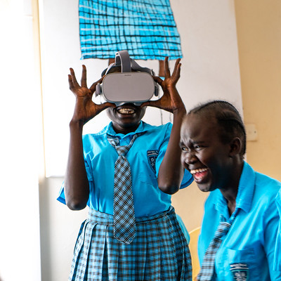 Students at Kenya's Kakuma refugee camp check out the artworks at London's National Gallery, with help from Vodafone.