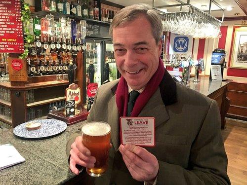 Nigel Farage, leader of the UK's Brexit Party, enjoying his favorite tipple.