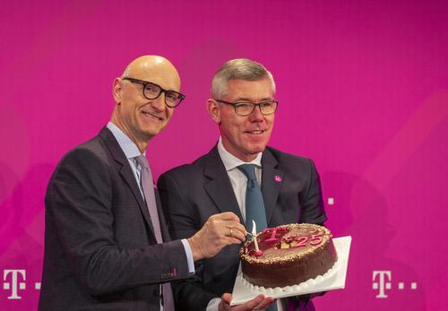 Deutsche Telekom CEO Timotheus Hottges (left) and CFO Christian Illek show off their cake-making skills.