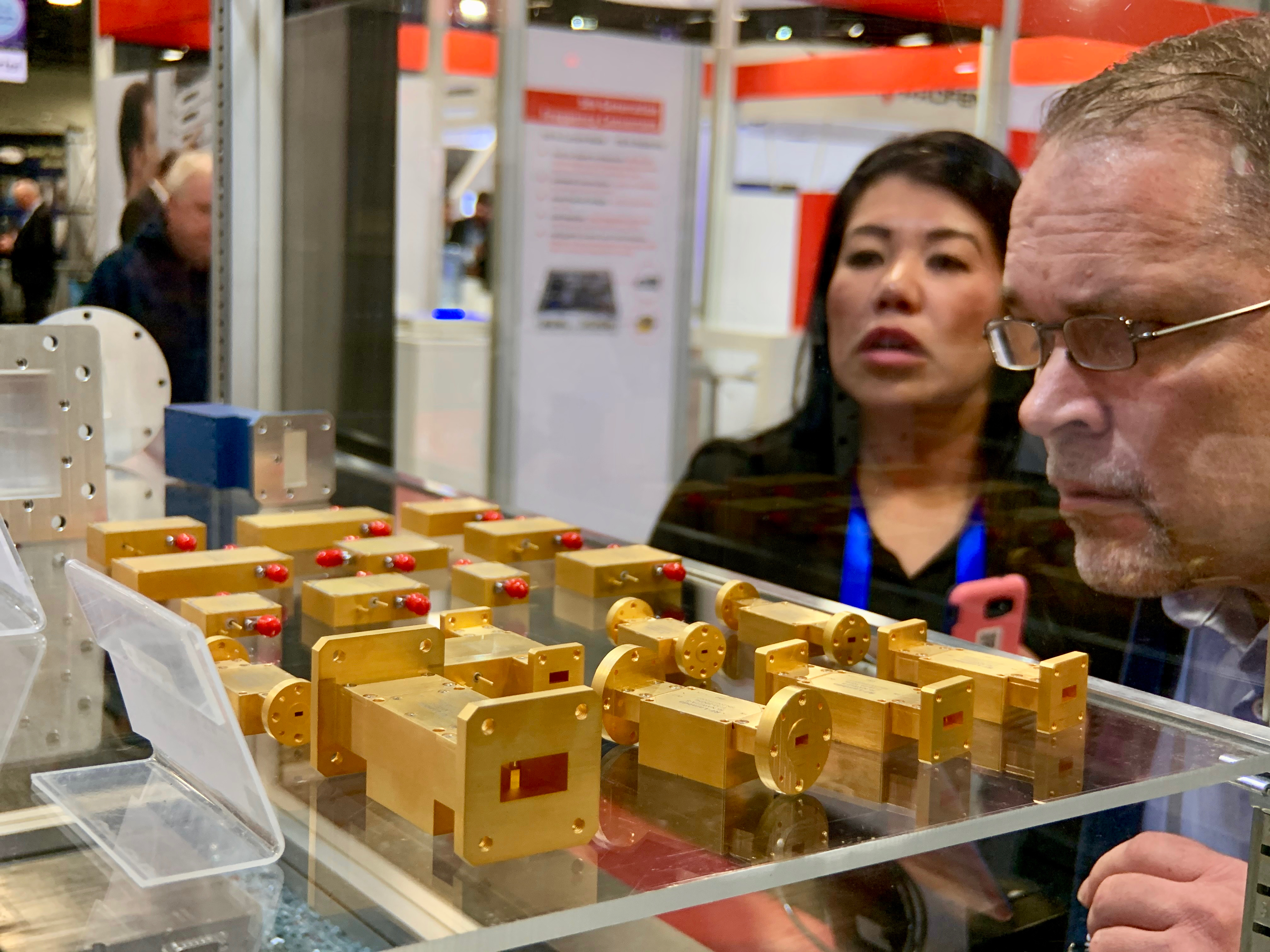 A potential buyer at the RF-Lambda booth gets a closer look at some broadband components.