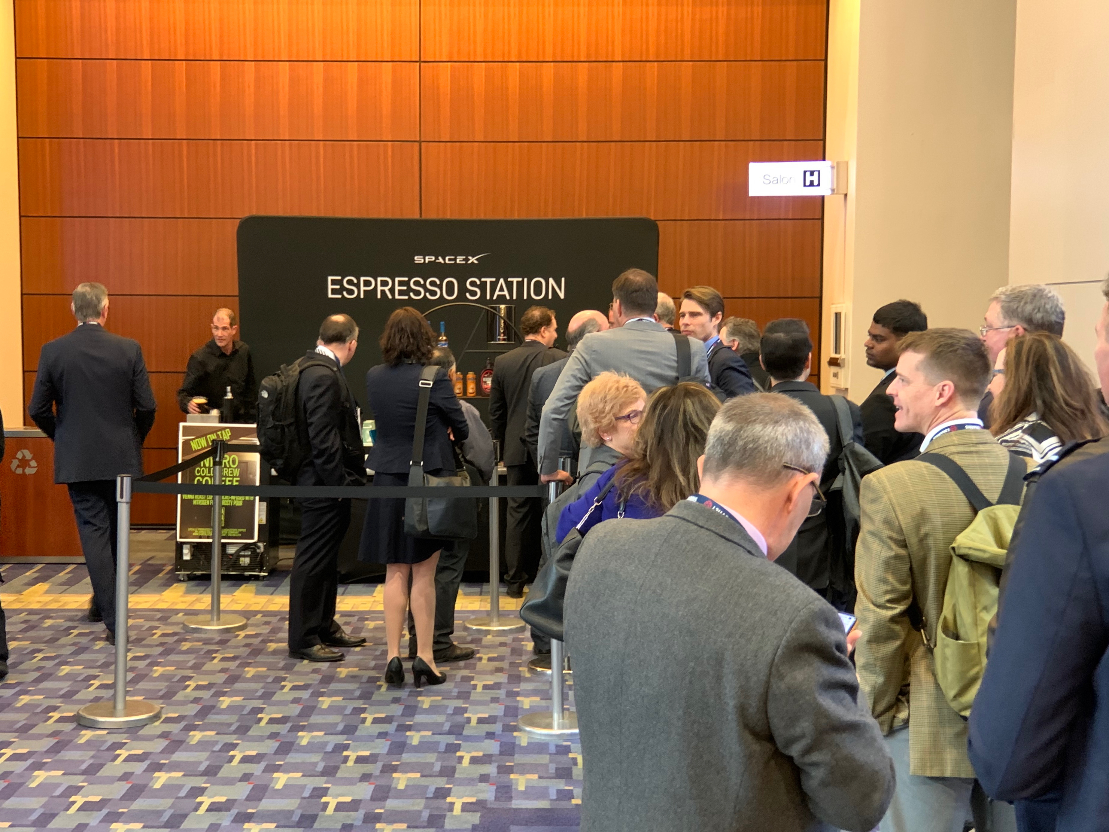 SpaceX sponsored a coffee counter outside the main registration area and it was easily the most popular stand at the whole show.