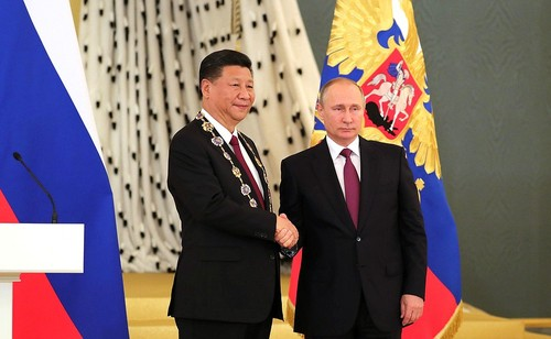 Xi Jinping of China pictured next to Russian peer Vladimir Putin.
