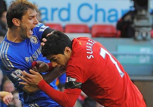 Luis Suarez bites Branislav Ivanović during a Liverpool-Chelsea clash.