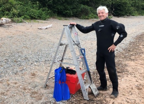 Scuba do: Openreach engineer John McConnell went subsea to reconnect the Scottish island of Balhama.
