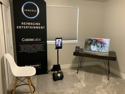 Debbie Fitzgerald of CableLabs drove the light field display demo in Ames remotely today via a telepresence robot.   Source: Derek Seaman for Mediacom)