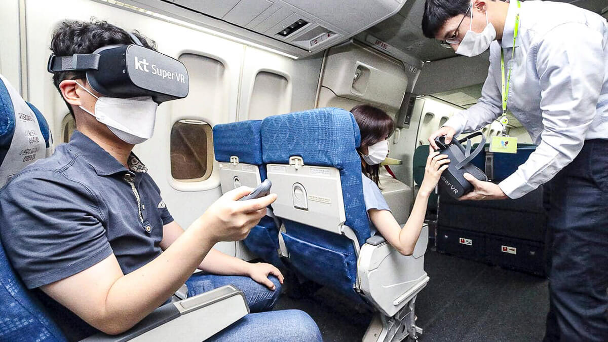 Mile high: Passengers on a flight view immersive media contents via the KT Super VR service, launched in September 2020.  (Source: KT Telecom)