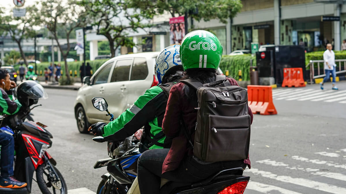 Grabbing the moment: Grab may be better known for ride-hailing across Asia - but it's taking on the telcos and banks for a piece of the payments pie.  (Source: Afif Kusuma on Unsplash)