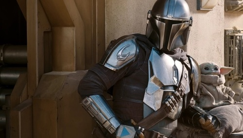 Season two of The Mandalorian launched just in time to keep Disney+ subs on year-long promos on the hook. Here one can see the star of The Mandalorian sitting next to The Mandalorian.  