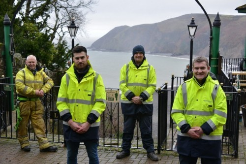 It's behind you! Openreach engineers and site manager Ashley Clarke (far left) fail to admire the view at Lynton & Lynmouth Cliff Railway.