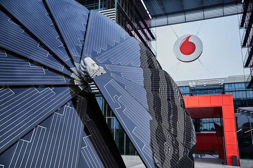 Flower power: Vodafone Plaza in Madrid is home to the 'Smartflower' solar panel, which imitates a sunflower's movement by automatically opening and closing at sunrise and sunset.   (Source: Vodafone)