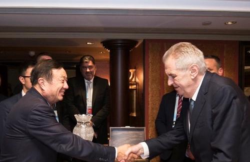 Huawei's Ren Zhengfei greets Czech President Milos Zeman in Beijing.