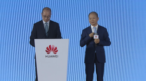 Huawei's Eric Xu (right) pictured next to his translator in Shenzhen today.