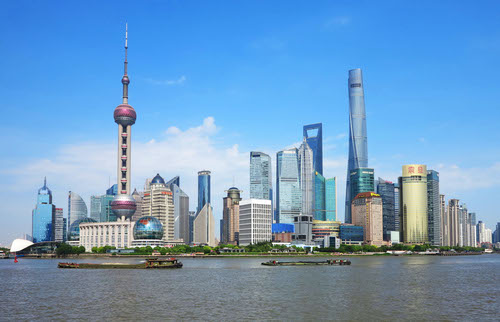 5G rollout in Shanghai (pictured) and other big cities will burnish China's hi-tech credentials.