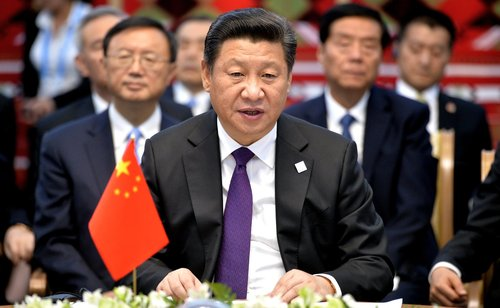 Xi Jinping, China's top gangster, addresses subordinates at a conference.
