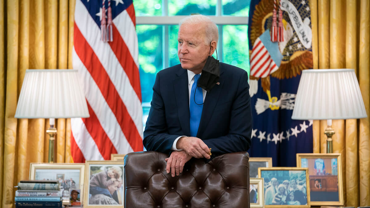 Sober reflection: Their methods might be poles apart - but when it comes to China, President Biden appears to share the same fears as his predecessor.  (Source: White House)