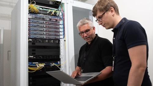 Technicians set up one of the baseband units featuring Intel's hardware.