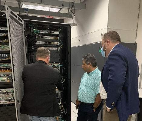 (L to R) Marty Fierbaugh, Cisco; Zeus Kerravala, ZK Research; and Robin Olds, Cisco, tour the lab portion of Cisco's Rural Broadband Innovation Center. Photo by Kelsey Ziser, Light Reading.