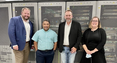 (L to R) Robin Olds, Cisco; Zeus Kerravala, ZK Research; Marty Fierbaugh, Cisco; and Kelsey Ziser, Light Reading at the Center's lab. Image source: Cisco.