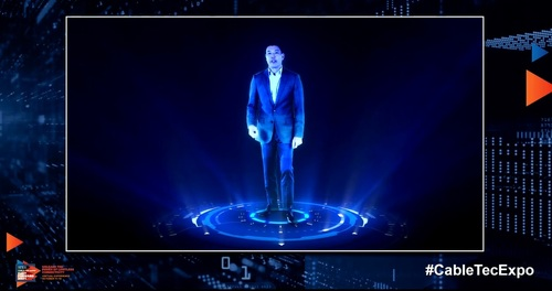 Charter's Andrew Ip presented in the form of a hologram to help illustrate the kind of applications that will require the speeds and low latencies supported by the cable industry's wide-ranging '10G' initiative. (Image source: SCTE Cable-Tec Expo)