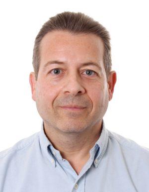A headshot of Dr. Daniel Tapias, CEO of Sigma technologies, who aim to unlock dark data