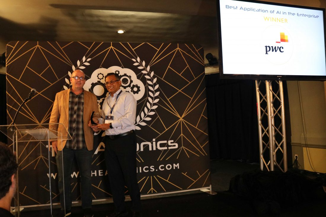 PwC's Anand Rao accepting the AIconics award for 'Best Application of AI in the Enterprise'