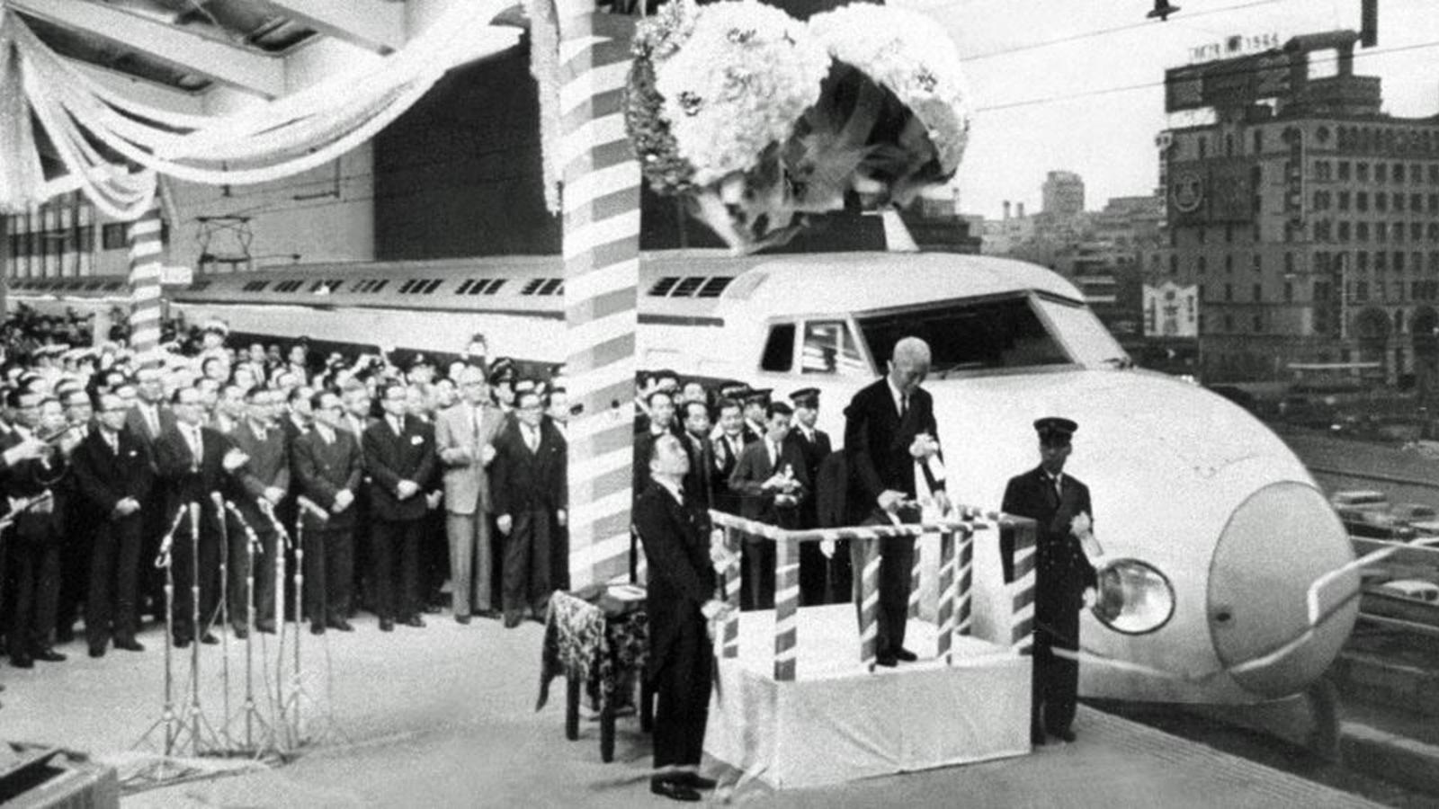 Emperor Showa cuts the ribbon on Japan 's first bullet train