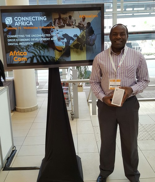 Safaricom's Musalia Kihamba with his prized iPhone 7.