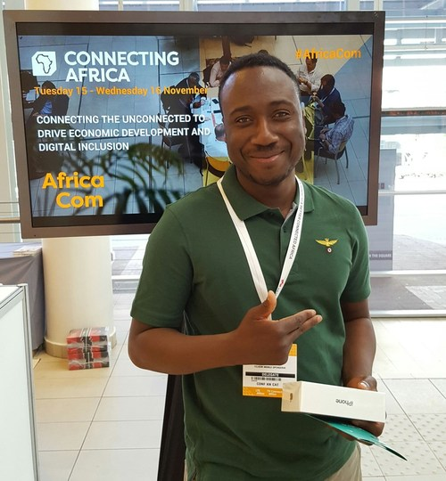 Telkom's Molatelo Mathikhithela with his iPhone 7 prize at the AfricaCom show.