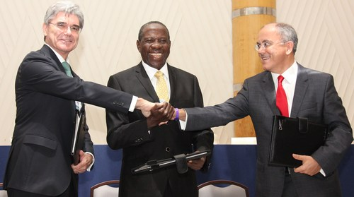 The signing of Uganda MOU (left to right): Joe Kaeser, Siemens Global President and CEO; Hon. Minister of Finance Matia Kasaija, Uganda; Mesut Sahin, CEO MMEC Mannesman, Germany.