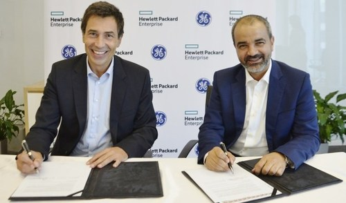 Johannes Koch (left), managing director, Middle East and Africa for HPE and Ali Saleh, senior vice president and chief commercial officer for GE Digital MEA try out their best smiles as they commit to a three-year partnership.