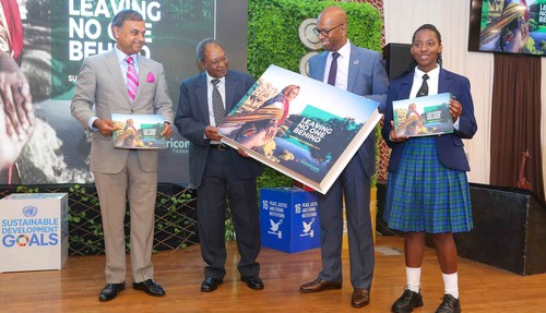 Safaricom Chairman, Nicholas Nganga (center left) and Safaricom CEO Bob Collymore (center right) mark the launch of the Safaricom Sustainability Report 2017 at the company's headquarters. Looking on is UN Resident Coordinator and UNDP Resident Representative, Siddharth Chatterjee (far left) and Ivy Waikwa, a student at the Mpesa Foundation Academy (far right).
