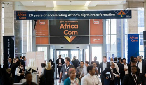 The doors open and delegates flood in on the first day of the 20th anniversary AfricaCom, November 7, 2017.
