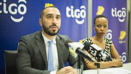 Tigo Tanzania's Chief Officer for Mobile Financial Services, Hussein Sayed (left), briefs journalists on how Tigo Pesa became one of the first mobile money services in the world to be certified under the GSMA's new scheme. With him is Tigo's Corporate Communications Manager, Woinde Shisael.