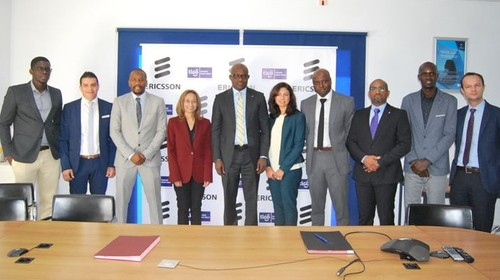 The Tigo Senegal and Ericsson teams line up to sign their network modernization deal.