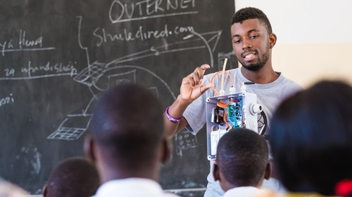 Code for Africa technologist Emmanuel Evance demonstrates sensors.AFRICA air quality hardware kits at schools in Tanzania.