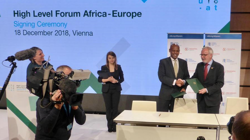 EIB President W. Hoyer and Bandwidth and Cloud Services CEO Y. Maru announcing EUR 15 million new EIB support for to improve communications in East Africa at Africa-Europe High-Level Forum in Vienna.
