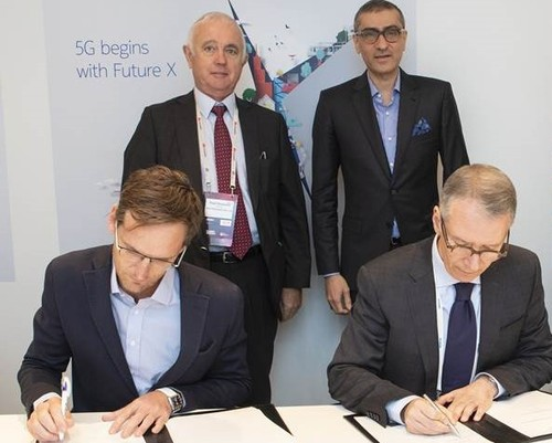 Executives from Rain and Nokia sign their 5G agreement. Back row, from left to right: Paul Harris, chairman of Rain; and Rajeev Suri, president and CEO, Nokia. Front row, from left to right:  Brandon Leigh, director, Rain; and Amr K. El Leithy, head of the Middle East and Africa market, Nokia.
