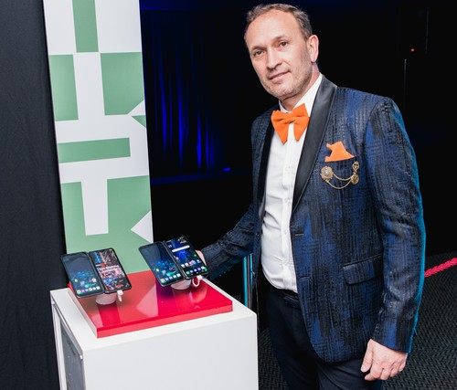 Vodacom CTO Andries Delport shows off his wardrobe during the 5G demos at the Durban July horse racing event.