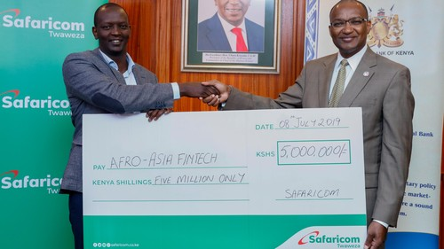 Central Bank of Kenya Governor, Dr. Patrick Njoroge (right) receives a Cheque worth KES 5 million from Safaricom Chief Financial Services Officer Sitoyo Lopokoiyit. Safaricom will be one of the sponsors of the inaugural Afro-Asia FinTech Festival 2019 which will be co-hosted by the Central Bank of Kenya (CBK) and Monetary Authority of Singapore (MAS) on 15-16 July at the Kenya School of Monetary studies.