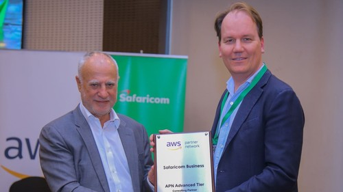 Safaricom CEO Michael Joseph accepts a partnership plaque from Amazon Web Services' managing director for emerging markets, Tony van den Berge.