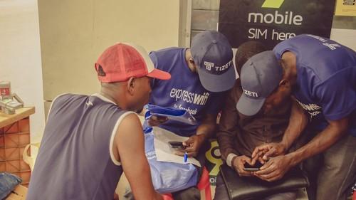 A Tizeti ambassador explaining the Express WiFi service to customers.