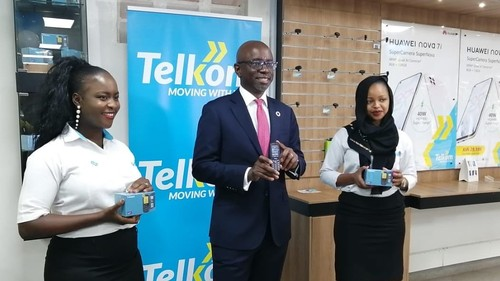Telkom Kenya's MD for consumer, Steve Okeyo, showcasing the new phones.