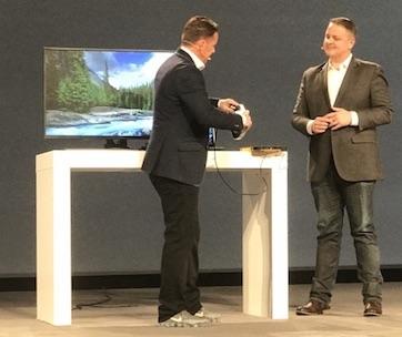 Dell's Jeremy Burton (left) gets a VR demo from Daqri's Brian Mullins.