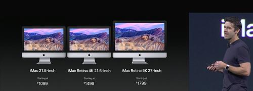 John Ternus, vice president for hardware engineering, shows off new iMacs.