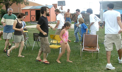Musical chairs. Photo by Artaxerxes (Own work) [CC BY-SA 3.0 or GFDL], via Wikimedia Commons